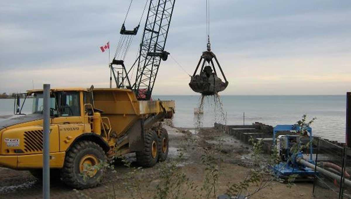 large yellow heavy machinery near waterfront