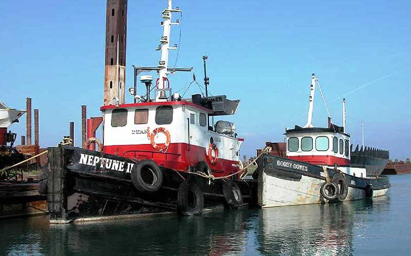 white, red, and black boat named Neptune III in body of water near dock